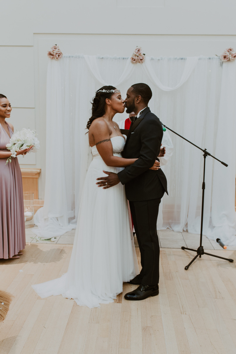 art-inspired levine museum wedding ceremony kiss