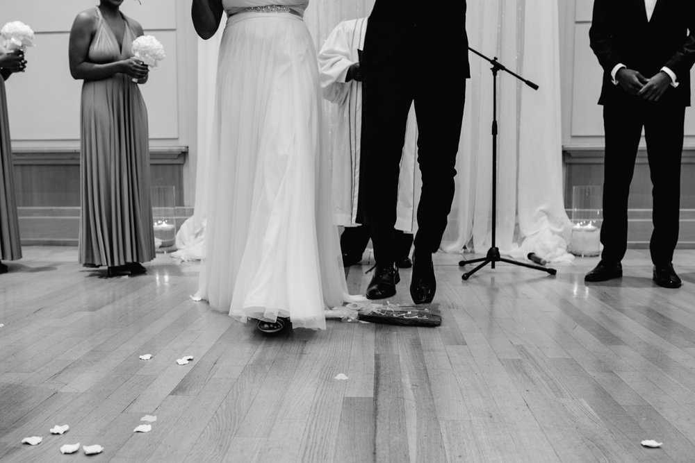 art-inspired levine museum wedding bride and groom waist down at altar