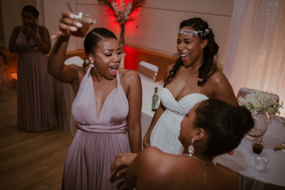 art-inspired levine museum wedding shavonne with bridesmaids, one holding up drink