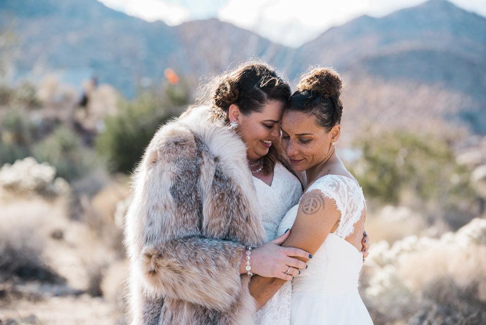 multi-cultural desert elopement embrace candid