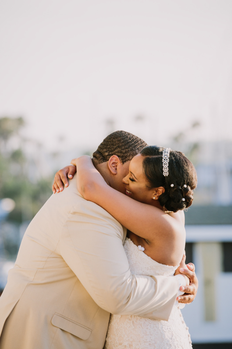 San Diego Tropical-Inspired Wedding couple hugging outside