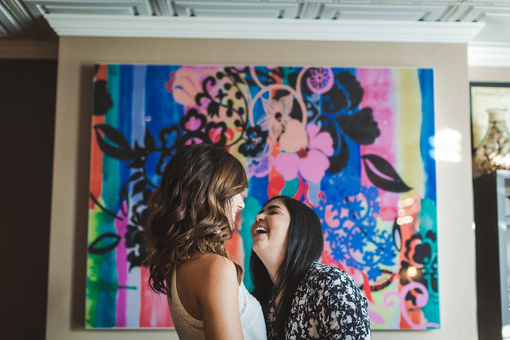 Wine Bar Engagement Virginia couple laughing in front of colorful mural
