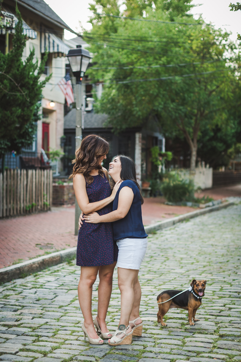 Wine Bar Engagement Virginia candid on cobblestone street