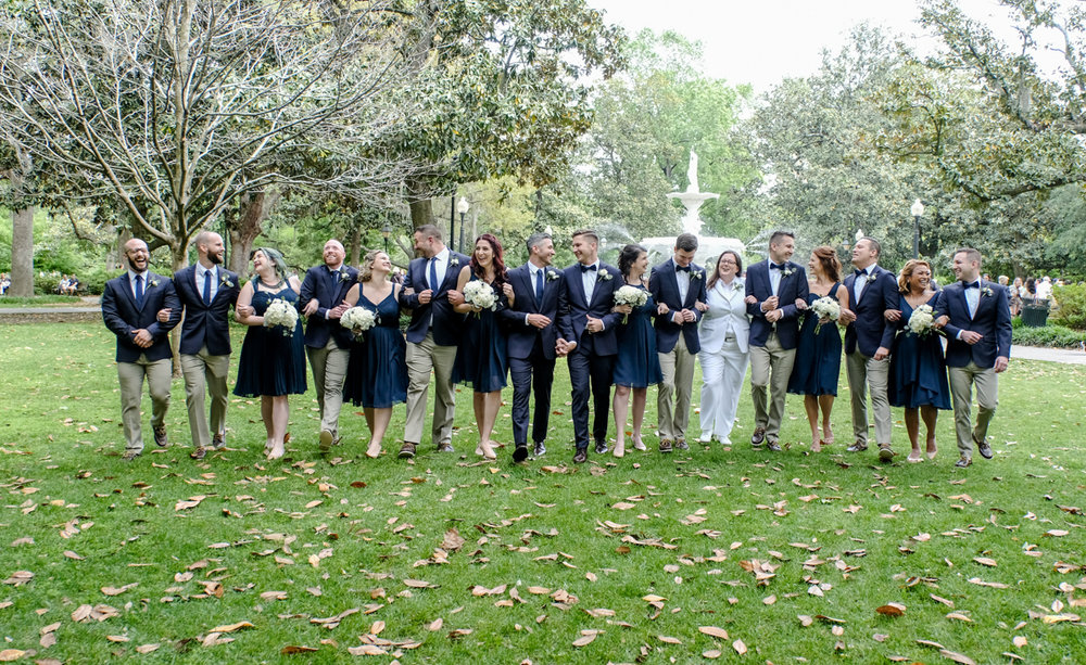 Classic southern style wedding savannah georgia wedding party in garden, arms linked, candid