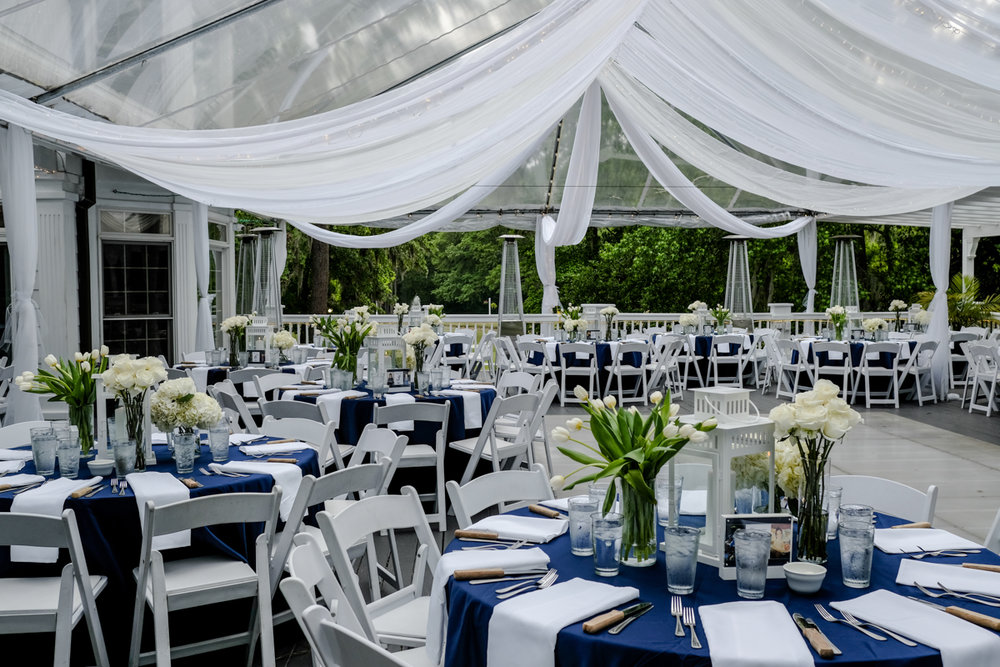 Classic southern style wedding savannah georgia outdoor reception area; empty tables with lantern and rose centerpieces