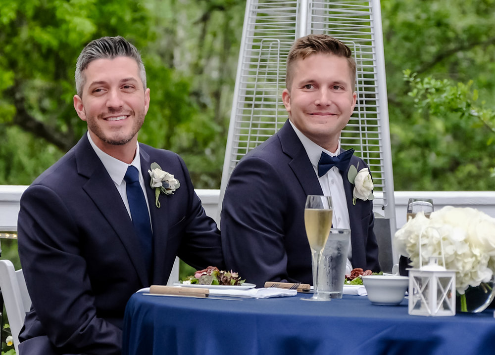 Classic southern style wedding savannah georgia candid of grooms at head table