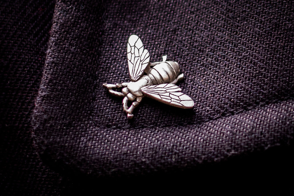lovers in havana close shot of insect pin on ishak's jacket collar
