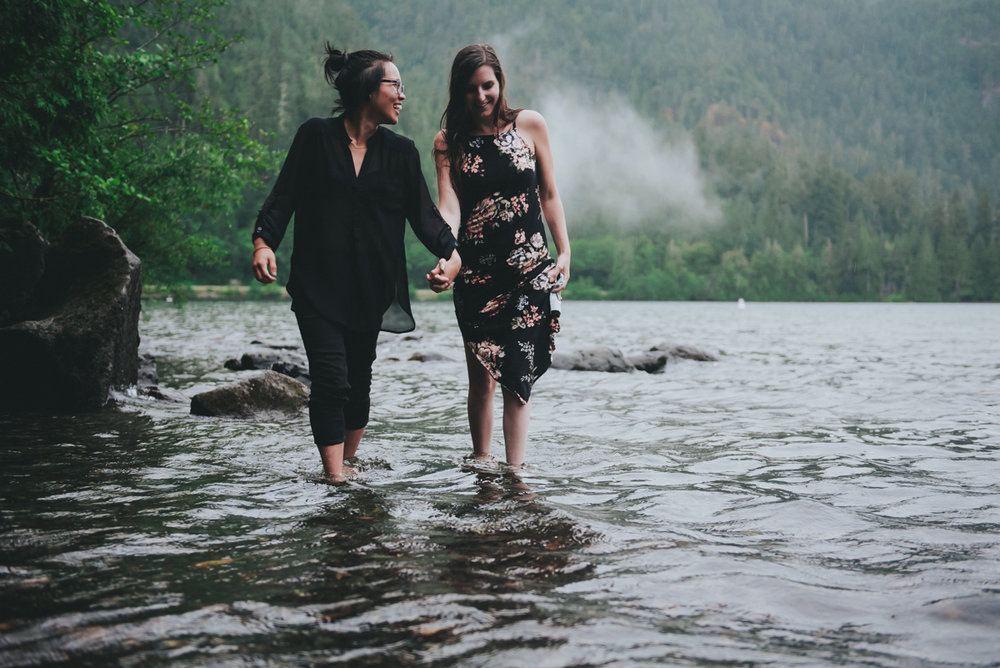 Cameron Lake Photo Session BC Canada couple walking in shallow water holding hands