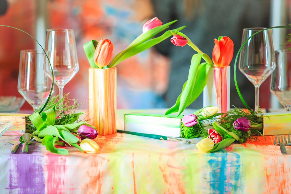 Love Out Loud Parker Colorado Styled Shoot table with wine glasses, tulips, and hand-painted flower boxes