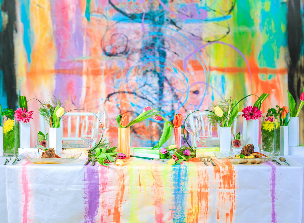 Love Out Loud Parker Colorado Styled Shoot table with colorful abstract mural in background