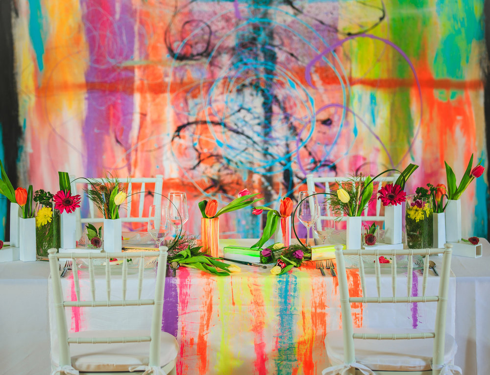 Love Out Loud Parker Colorado Styled Shoot table with chairs and abstract mural in background