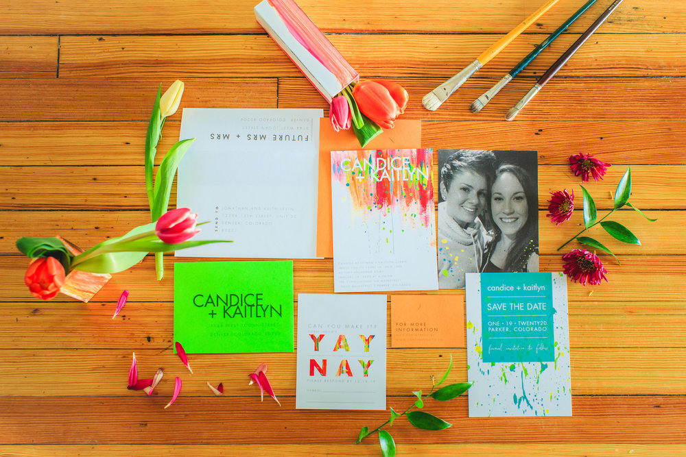 Love Out Loud Parker Colorado Styled Shoot spread of wedding announcement, picture of the couple, save the date, rsvp, and invitation with flowers and paintbrushes