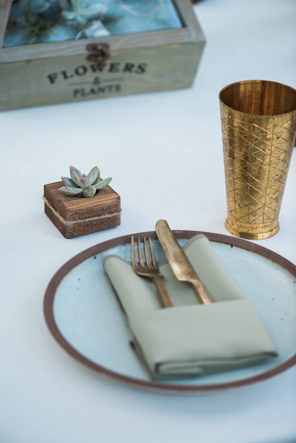 circle oak ranch farm wedding california guest table setting including small wooden plant holder with succulent