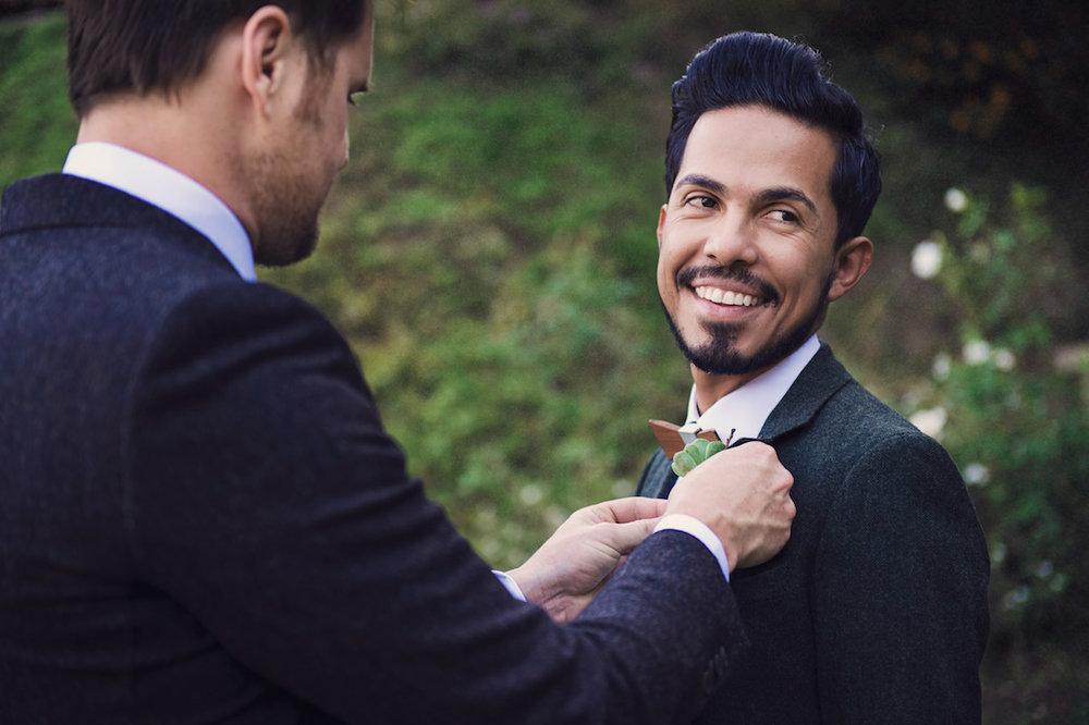 circle oak ranch farm wedding california groom having flower pinned to suit jacket
