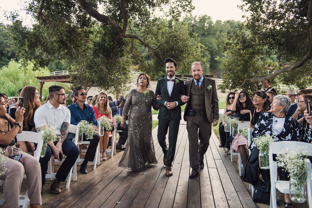 circle oak ranch farm wedding california other groom walking down aisle with mother and father