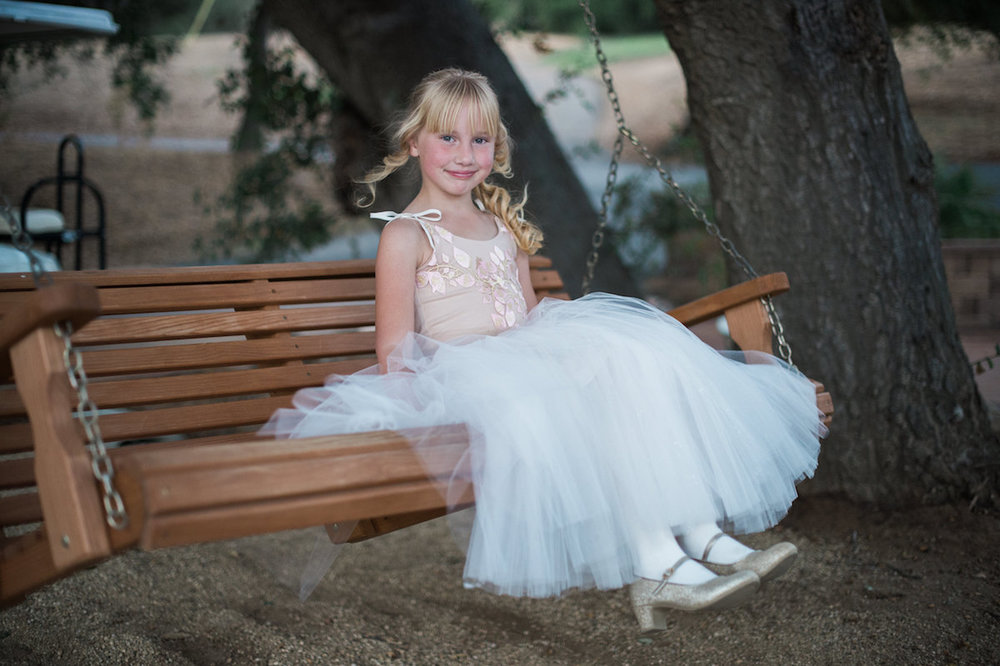 circle oak ranch farm wedding california young guest on swinging bench
