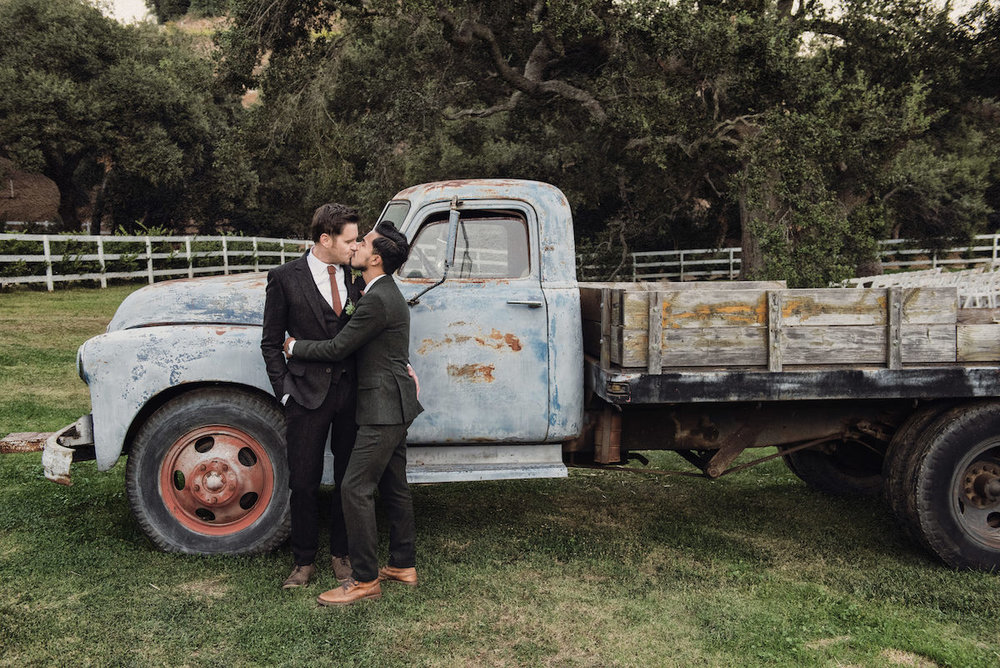 circle oak ranch farm wedding california kiss in front of old truck
