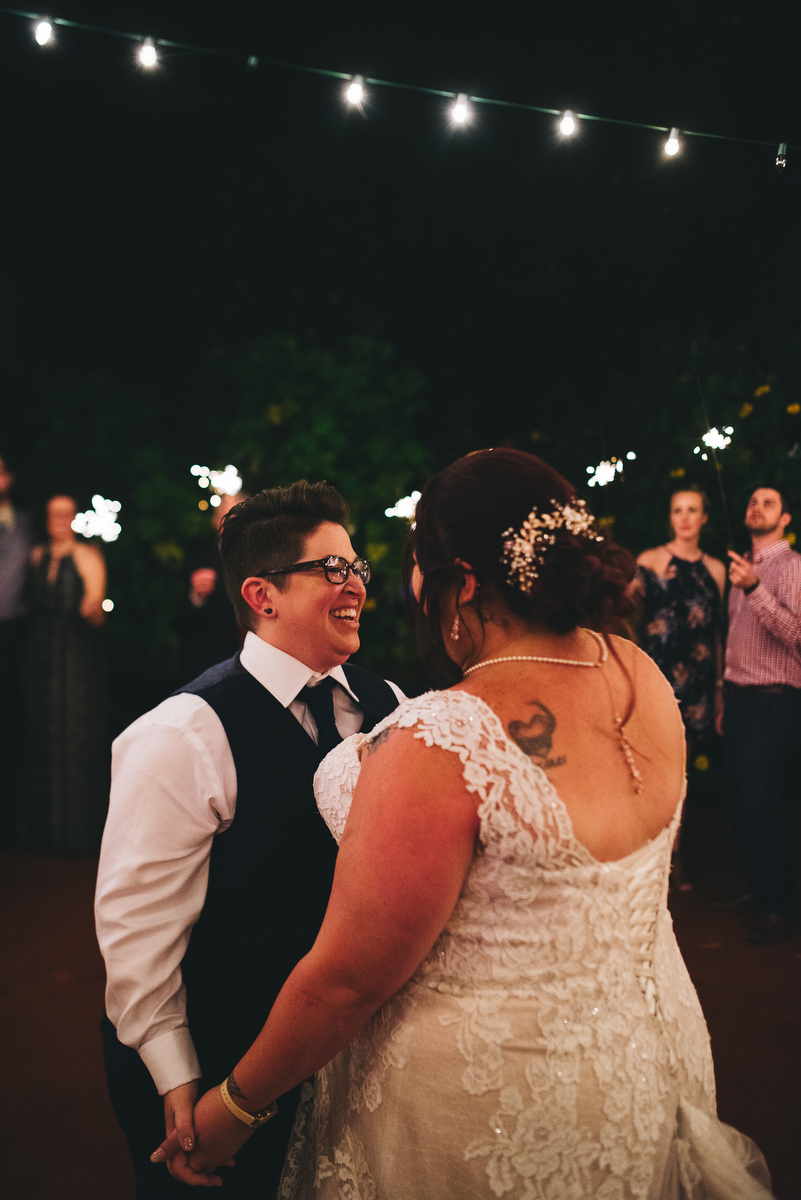 fairytale garden wedding vero beach florida samantha and stephanie in dance floor while guests hold sparklers