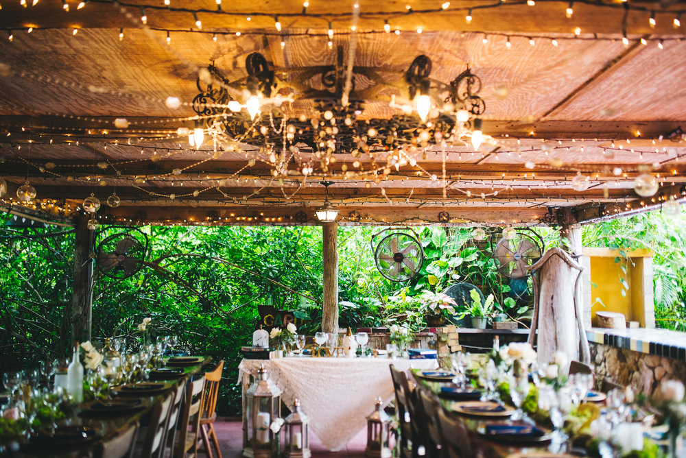 fairytale garden wedding vero beach florida reception venue dining area under chandelier and fairy lights