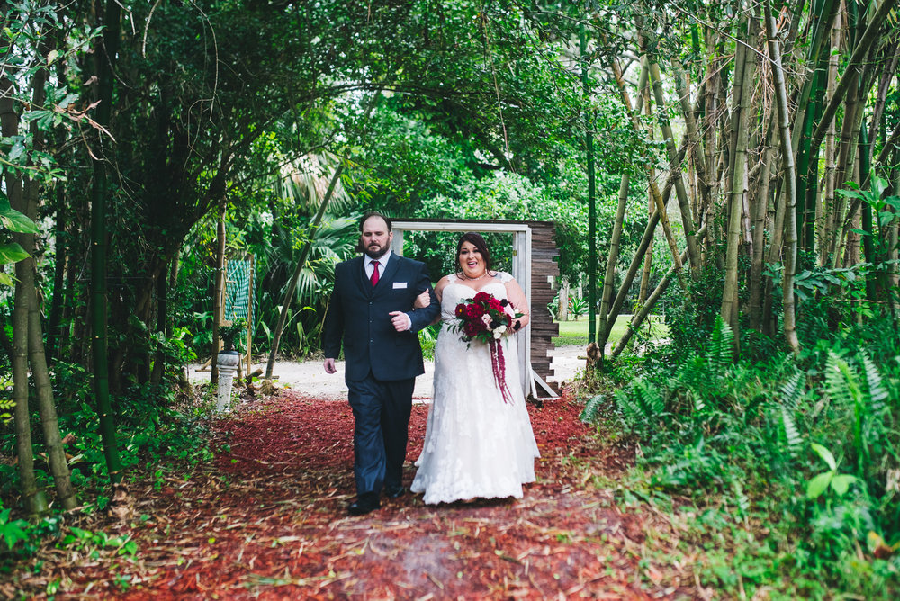 fairytale garden wedding vero beach florida samantha walking down garden path aisle