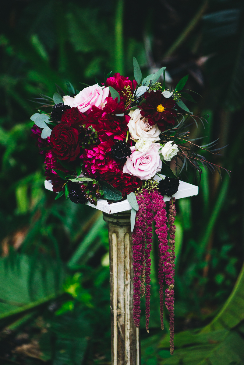 fairytale garden wedding vero beach florida samantha's bouquet on stone pedestal