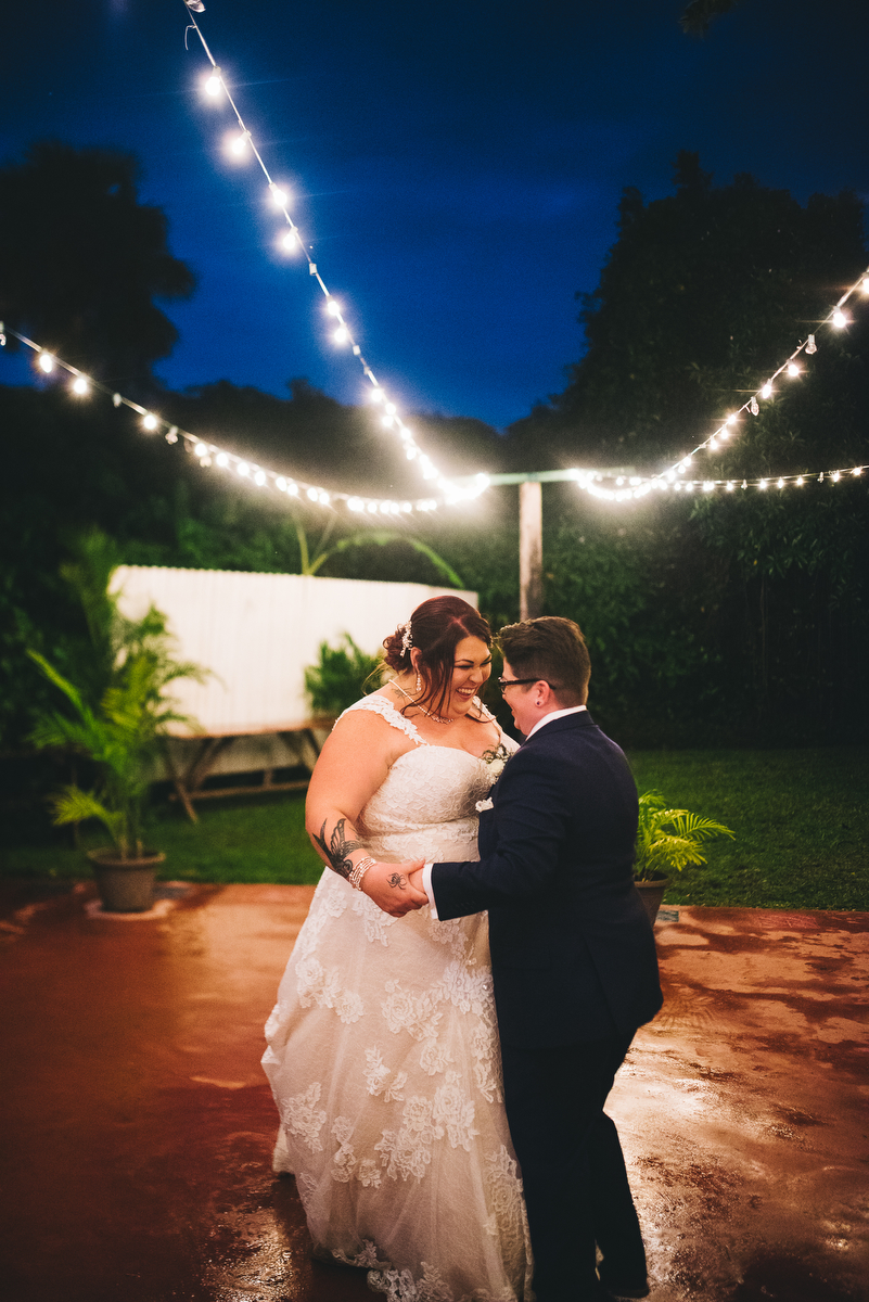 fairytale garden wedding vero beach florida couple dancing under strings of lights on garden patio