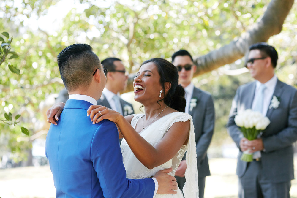 sri lankan, chinese, and harry potter wedding sydney australia candid of couple laughing with groomsmen in background wearing sunglasses