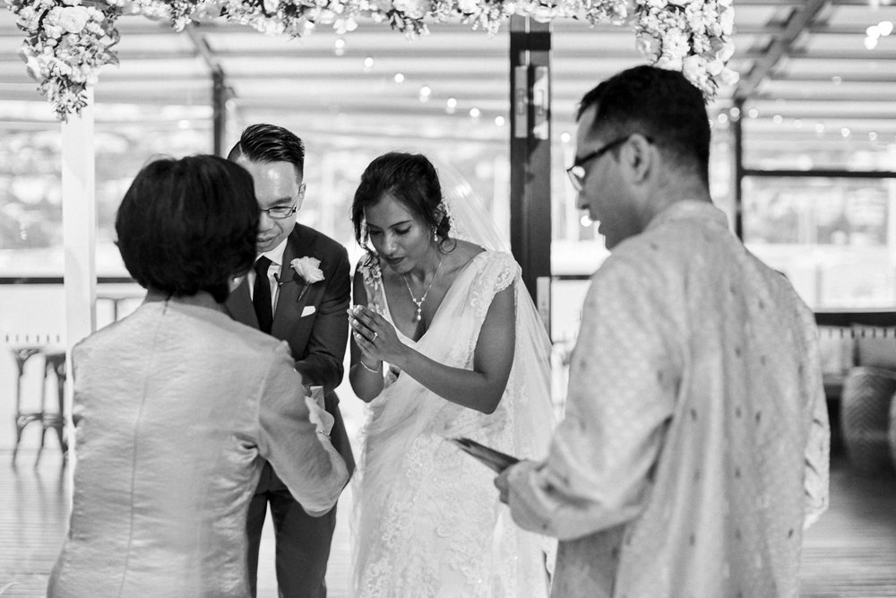 sri lankan, chinese, and harry potter wedding sydney australia couple bowing during ceremony