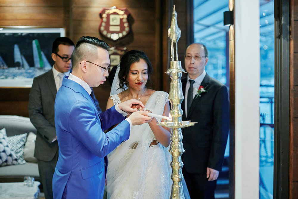 sri lankan, chinese, and harry potter wedding sydney australia couple lighting candles