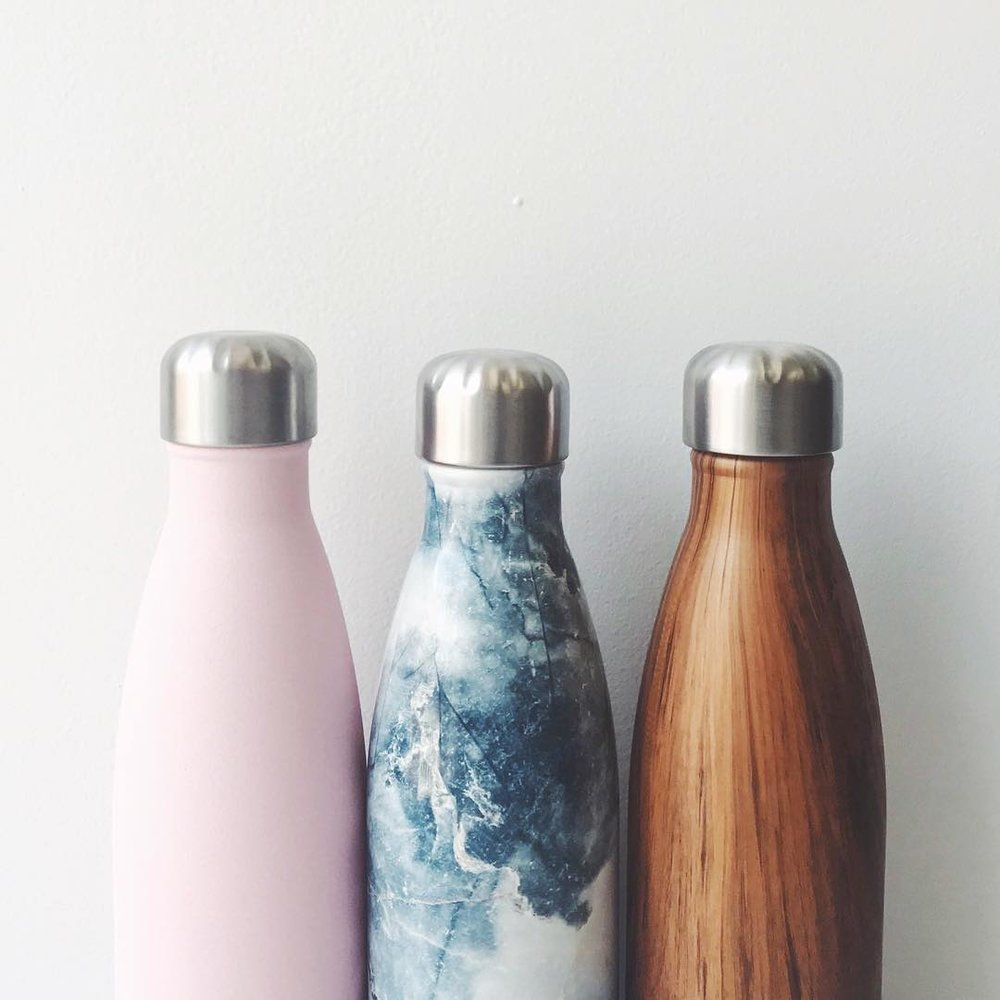 10 stylish gifts to give your wedding party s'well bottles, one pink, one blue marble, one wood grain