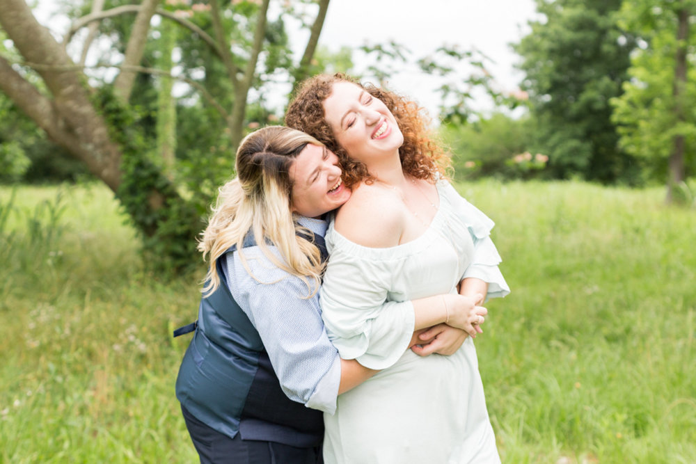 samantha and english hugging in a field newlywed portrait columbia south carolina jessica hunt photography