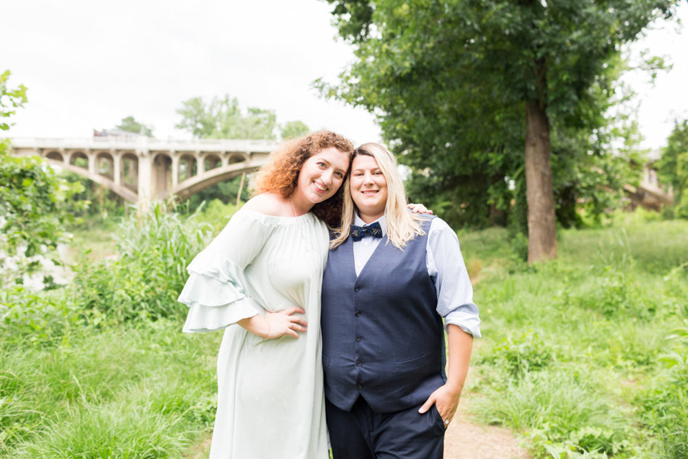 two brides LGBTQ newlywed portraits in field by bridge columbia south carolina jessica hunt photography
