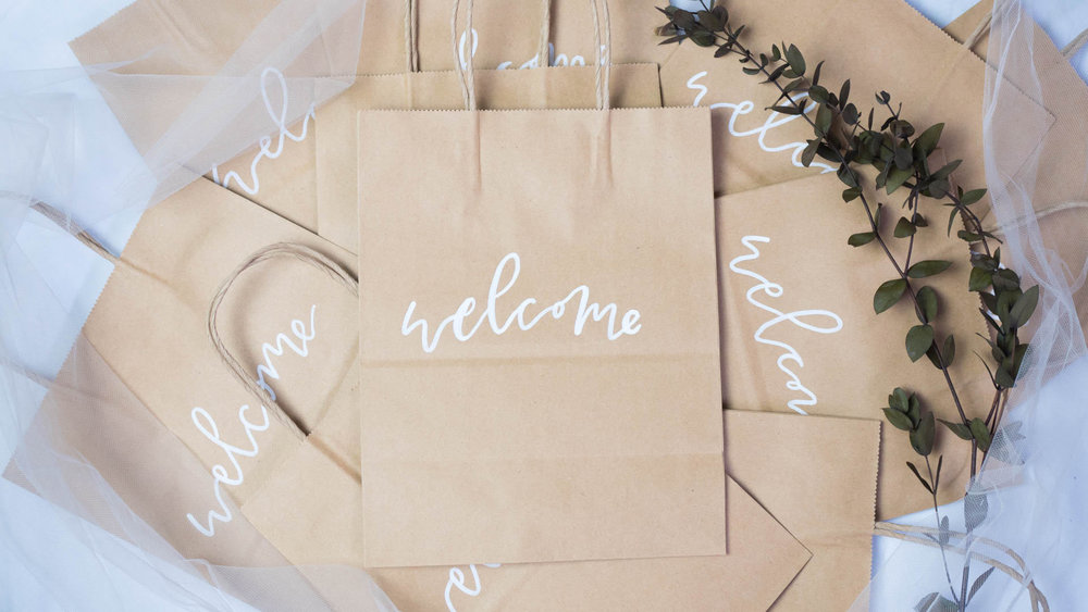 Hand-lettered Kraft Paper Welcome Bags by Evergreen Event Shop