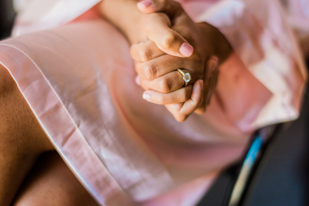 classic diverse wedding in washington dc zoe's hands together wearing engagement ring