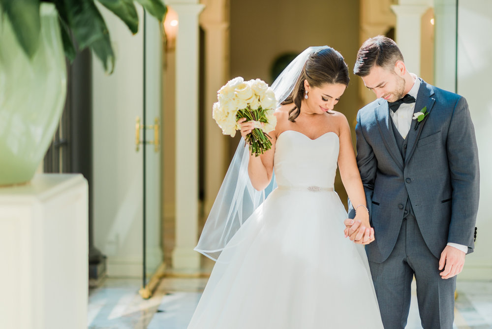 classic diverse wedding in washington dc kevin and zoe holding hands walking down hallway