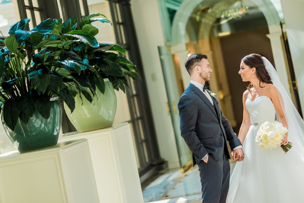 classic diverse wedding in washington dc zoe and kevin holding hands in hall
