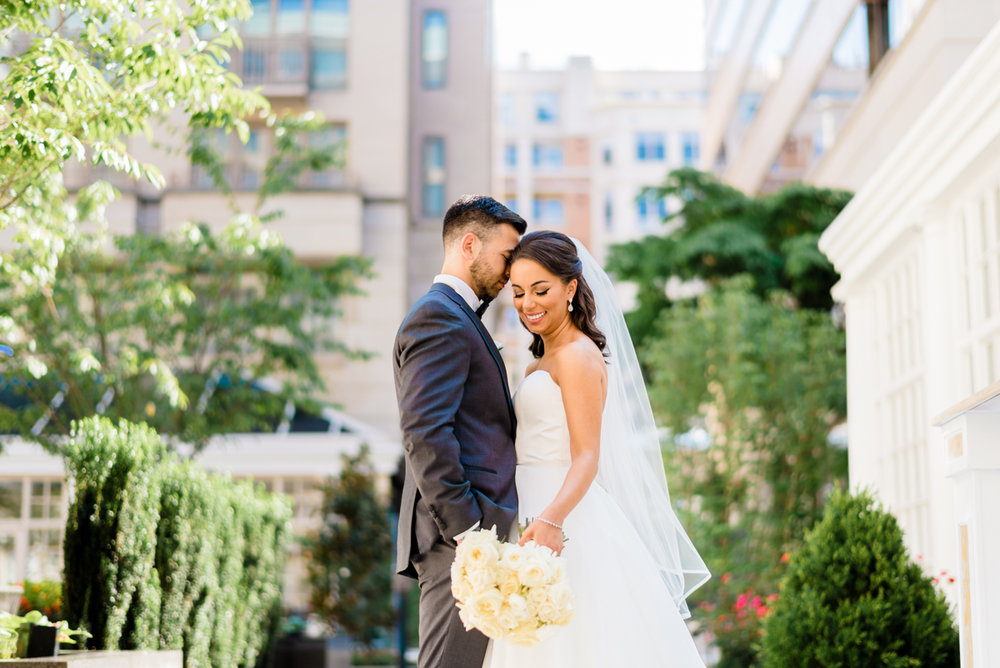 classic diverse wedding in washington dc couple in courtyard, buildings in background