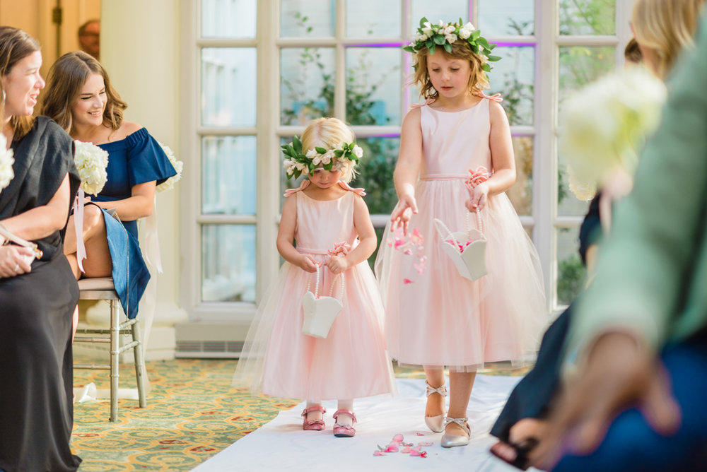 classic diverse wedding in washington dc flower girls scattering petals up aisle