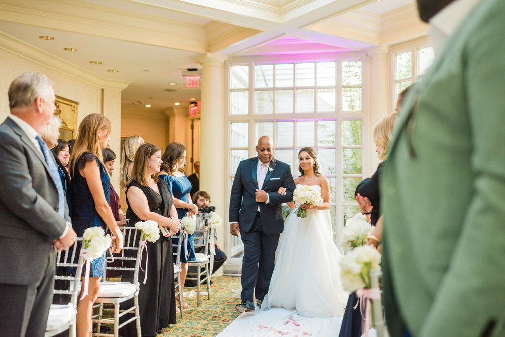 classic diverse wedding in washington dc zoe and her father walking down aisle