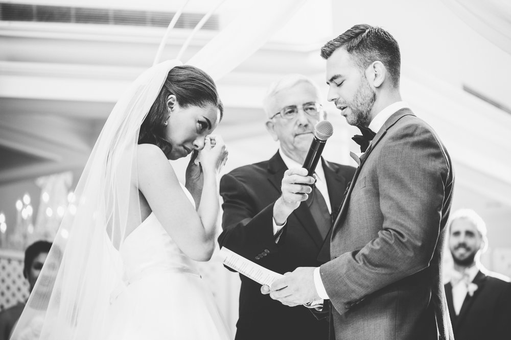 classic diverse wedding in washington dc kevin reading vows while zoe wipes away tears