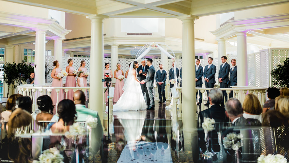 classic diverse wedding in washington dc wedding altar from behind guests