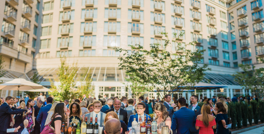 classic diverse wedding in washington dc reception at outdoor patio of hotel