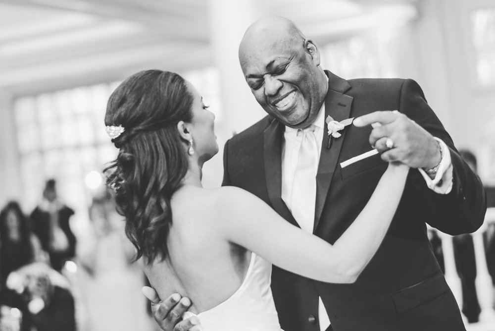 classic diverse wedding in washington dc zoe dancing with her father, both smiling