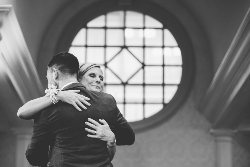 classic diverse wedding in washington dc kevin dancing with mother, mother smiling, large window in background