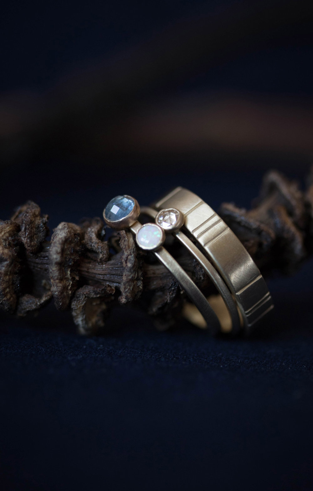Breakwater Wedding Band ,  Terence Rosecut Diamond Wedding Ring , and  Sapphire and Opal Tacita Wedding Ring