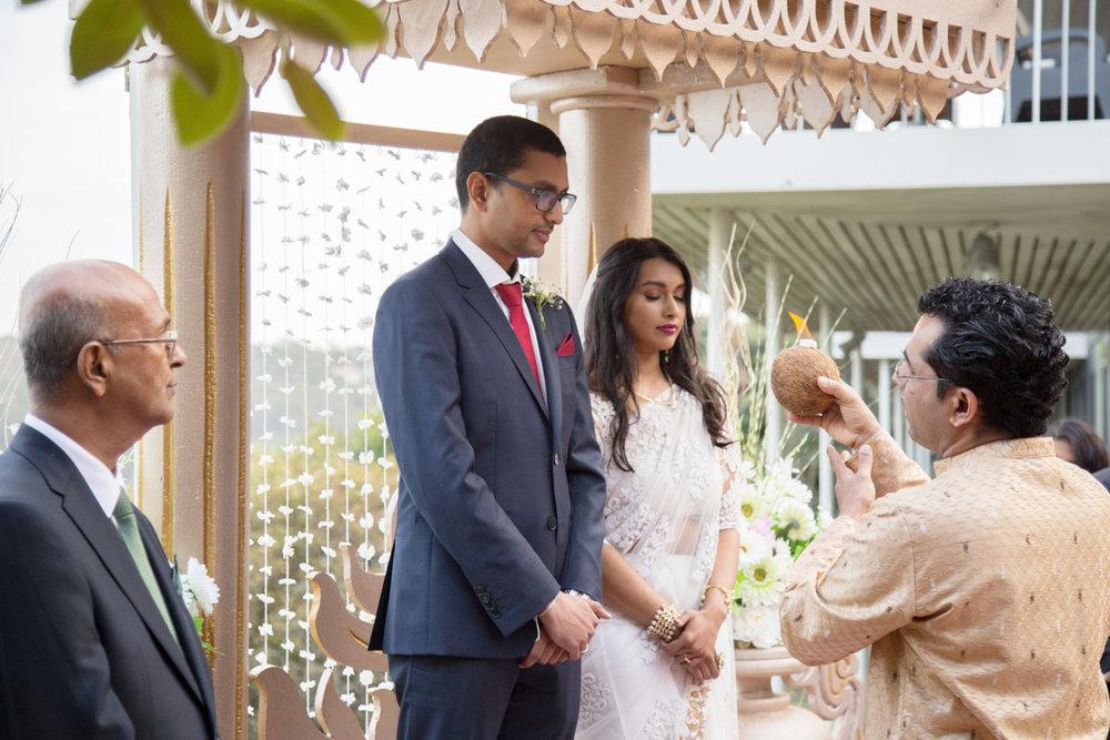 sri lankan wedding in sydney australia pundit holding candle during ceremony