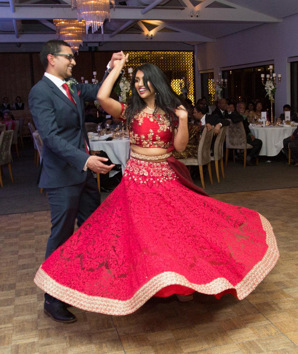 sri lankan wedding in sydney australia couple dancing, abirami's reception skirt twirling