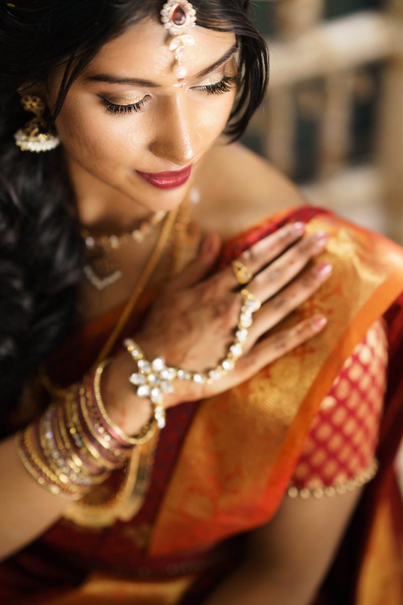 sri lankan wedding in sydney australia abirami posing with hand on shoulder to show bracelets