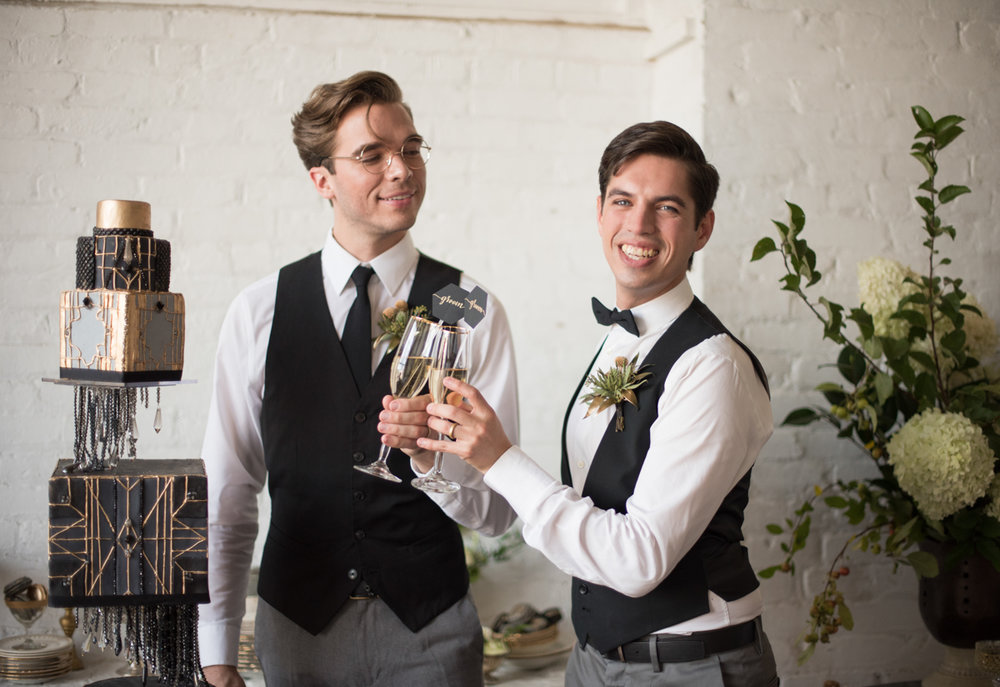 vintage wedding editorial at the art factory paterson new jersey couple toasting with champagne