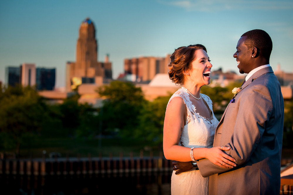 New York City skyline wedding couple first look embracing and laughing Jacqueline Connor Photography